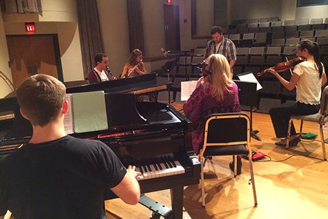 Ensemble Ibis practices together on stage